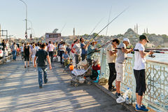 Fishermen and tourists are on the Galata Bridge on may 26, 2013 Stock Photography