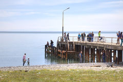 Fishermen and tourists on the pier Royalty Free Stock Photo