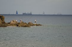 Fishermen and transatlantic race in the background. stock photo