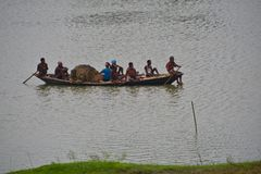 Fishermen travelling on a boat in the river stock images