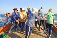 Fishermen are trawling for tuna fish in the sea of Nha Trang bay in Vietnam Stock Image