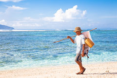Fishermen  on tropical beach Royalty Free Stock Images