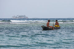 Fishermen in tropical water Stock Photography