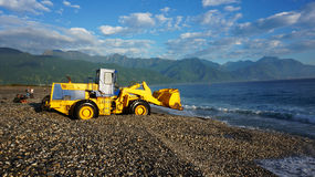 Fishermen unload the fishes from the boat by using truck in Hualien, Taiwan. HUALIEN, TAIWAN-NOV 24: Fishermen unload the fishes from the boat by using truck in royalty free stock image