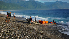 Fishermen unload the fishes from the boat by using truck in Hualien Taiwan. HUALIEN TAIWAN-NOV 24: Fishermen unload the fishes from the boat by using truck in royalty free stock images