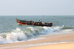 Fishermen unload fresh catch of fish on beach Stock Photography