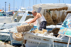 Fishermen unloading boat at the fishing Village of Chania town Stock Photography