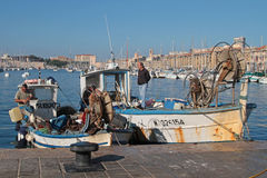 Fishermen in Vieux-Port of Marseilles Royalty Free Stock Image