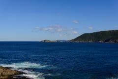 Fishermen village on coastline Stock Images