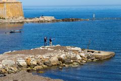 Fishermen wait for boat in Trapani Stock Photography