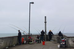 Fishermen Waiting on the Pier Royalty Free Stock Image