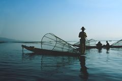 Fishermen on water. Inage of fishermen on water Royalty Free Stock Photo