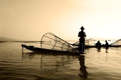 Fishermen on water royalty free stock photo