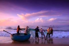 Fishermen who drag nets at sunrise Stock Images