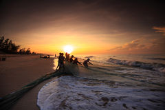 Fishermen who drag nets at sunrise Royalty Free Stock Images