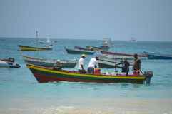 Fishermen on wooden boat catches. The beach. Magnificent azure sea. Fishing is a livelihood for the local Cape Verdeans. Sal - Santa Maria-cape verde Royalty Free Stock Photography