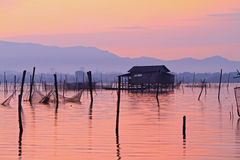 Fishermen wooden houses on stilts at dawn Stock Photo