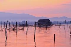 Fishermen wooden houses on stilts at dawn. Traditional fishermen wooden houses on stilts at dawn. Songkhla lake, Thailand Stock Photo