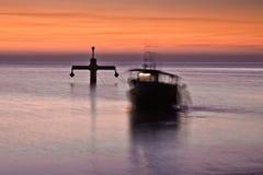 Fishermen at work. Fishermen fishing in the Baltic at sunrise stock photo