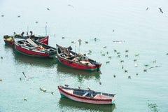 Fishermen wooden boats. Fishermen  in Morocco near El Jadida Stock Photo