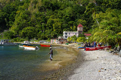 Fishermen working on the beach in the Soufriere village on January 06, 2017. Dominica royalty free stock image