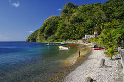 Fishermen working on the beach in the Soufriere village on January 06, 2017. Dominica. SOUFRIERE, DOMINICA - JANUARY 6, 2017 - Fishermen working on the beach in royalty free stock images