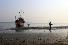 Fishermen Working. Digha, West Bengal in India on 7th February in 2017 - Fishermen collect fish in the coast of Digha, India Stock Photo