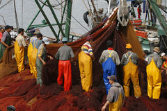 Fishermen working at Essaouira, Morocco Royalty Free Stock Images