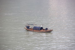 Fishermen on the Yangtze River amid heavy air and water pollution in China Royalty Free Stock Images