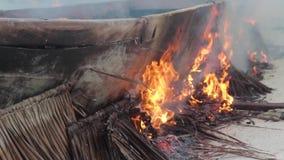 Fishermen in Zanzibar dry their boats. stock video footage