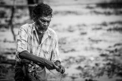 fishermens, die am frühen Morgen in ihren hölzernen Booten fischen Stockfotografie