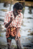fishermens, die am frühen Morgen in ihren hölzernen Booten fischen Stockfotos