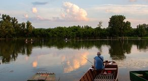 Fishermens are fishing from the boat