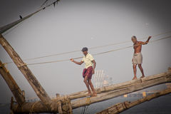 Fishermens fishing in their wooden boats Stock Images