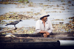 Fishermens fishing in their wooden boats Stock Photo