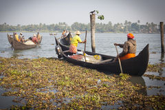 Fishermens fishing in their wooden boats Royalty Free Stock Images