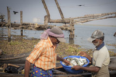 Fishermens fishing in their wooden boats Royalty Free Stock Photo
