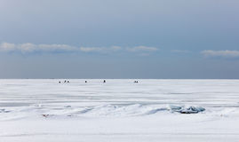 Fishermens on ice Stock Photography