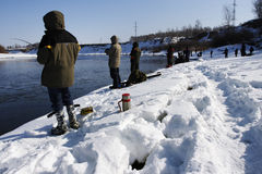 Fishers. Winter fishing at sunny day stock image