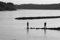 Fishers. On the confluence of Rivers - Danube Stock Photos