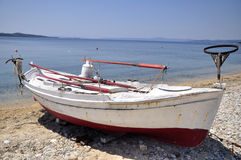 Fishers boat on coast Royalty Free Stock Photo