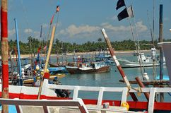 Fishers boats in the tropical harbour by the sea Stock Photo
