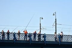 Fishers on Galata Bridge Royalty Free Stock Images