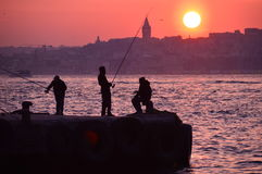 Fishers. Are hanging out by the sunset. in istanbul Royalty Free Stock Image