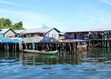 Fishers houses above sea. With drying fish nets in Sorong (Papua Barat, Indonesia Stock Photo