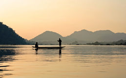 Fishers on the Mekong during sunset royalty free stock photos