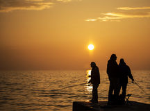 Fishers are patiently waiting for fish stock photography