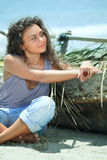 Fisherwoman. Young beautiful fisherwoman with boat on the beach royalty free stock images