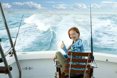 Fisherwoman big game on boat chair ok sign Stock Image