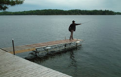 Fisherwoman casting her line, Ontario Canada Stock Photo